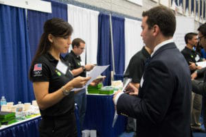 student and recruiter talking at career fair